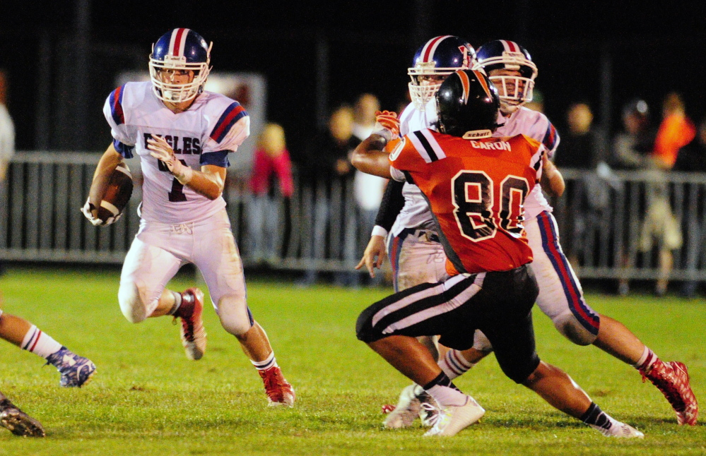 Staff photo by Joe Phelan   Messalonskee halfback Colby Dexter looks for room to run during a Pine Tree Conference Class B game Friday night against Gardiner at Hoch Field.