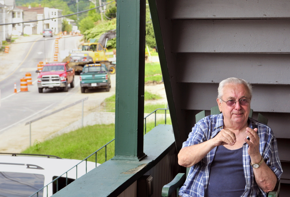 Roger Jean chats with visitors Thursday on the porch of the Mount Vernon Avenue home where he's lived most of his life as construction continues on Mount Vernon Avenue in Augusta.