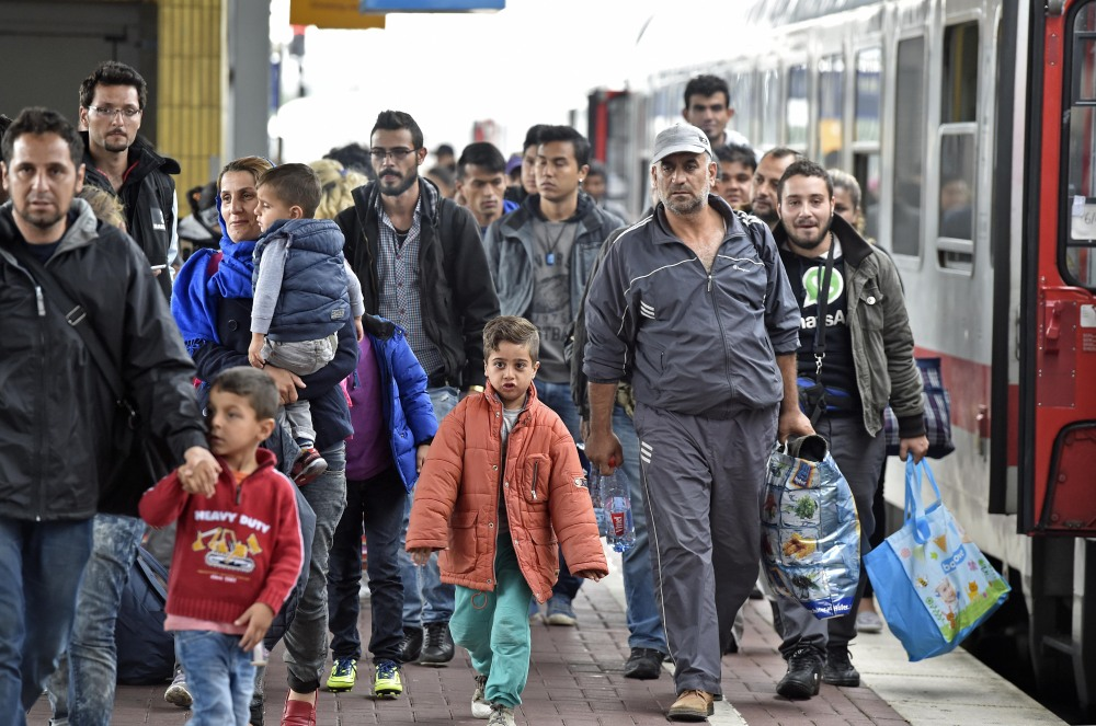 Refugees from Syria arrive at the train station  in Dortmund, Germany, on Sunday.