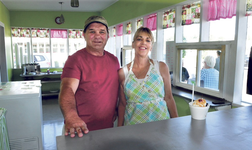 Scott and Vicki Stanchfield on opening day Friday, at Here's the Scoop in Bingham. The business was damaged severely two years ago in an arson fire.