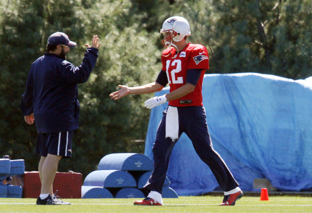 New England Patriots quarterback Tom Brady, right, greets Patriots defensive coordinator Matt Patricia at the start of practice Saturday in Foxborough, Mass. Brady will start against the Pittsburgh Steelers on Thursday night's season opener after a federal judge overturned Brady's four-game suspension last Thursday.