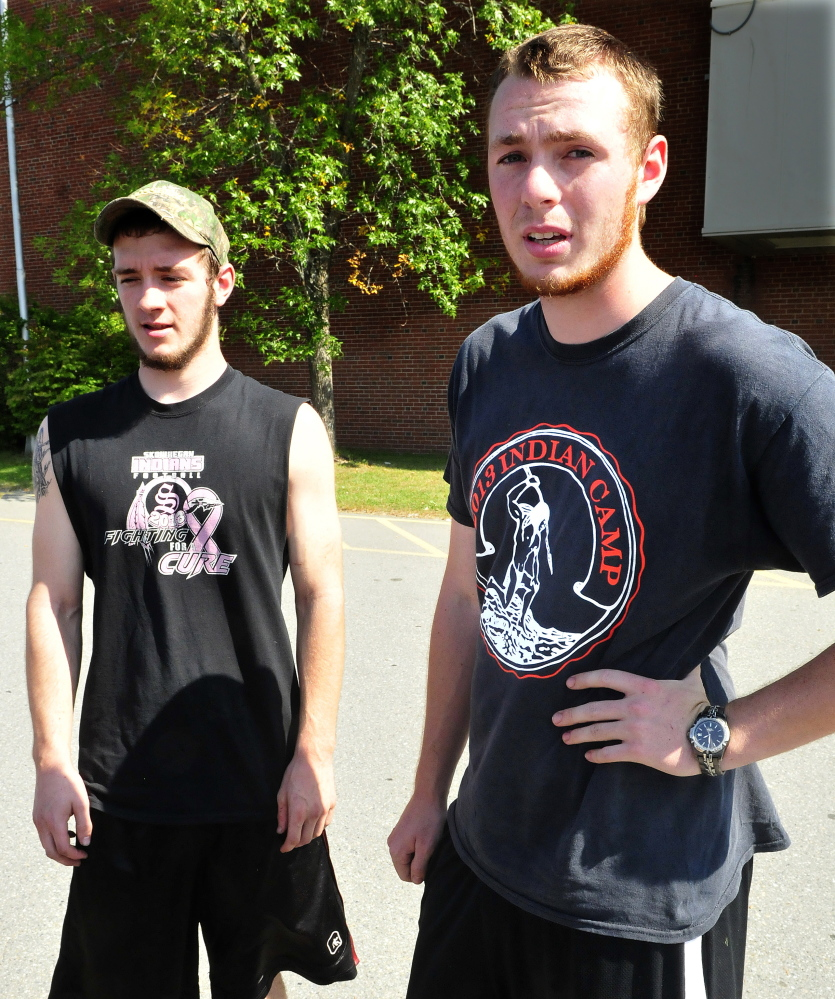 Former Skowhegan Area High School football players Josh Meng, left, and Dan Quirion speak about their friend and classmate Scott Brown after a memorial gathering Monday at the school. Brown died Sunday evening while swimming in Embden Pond.