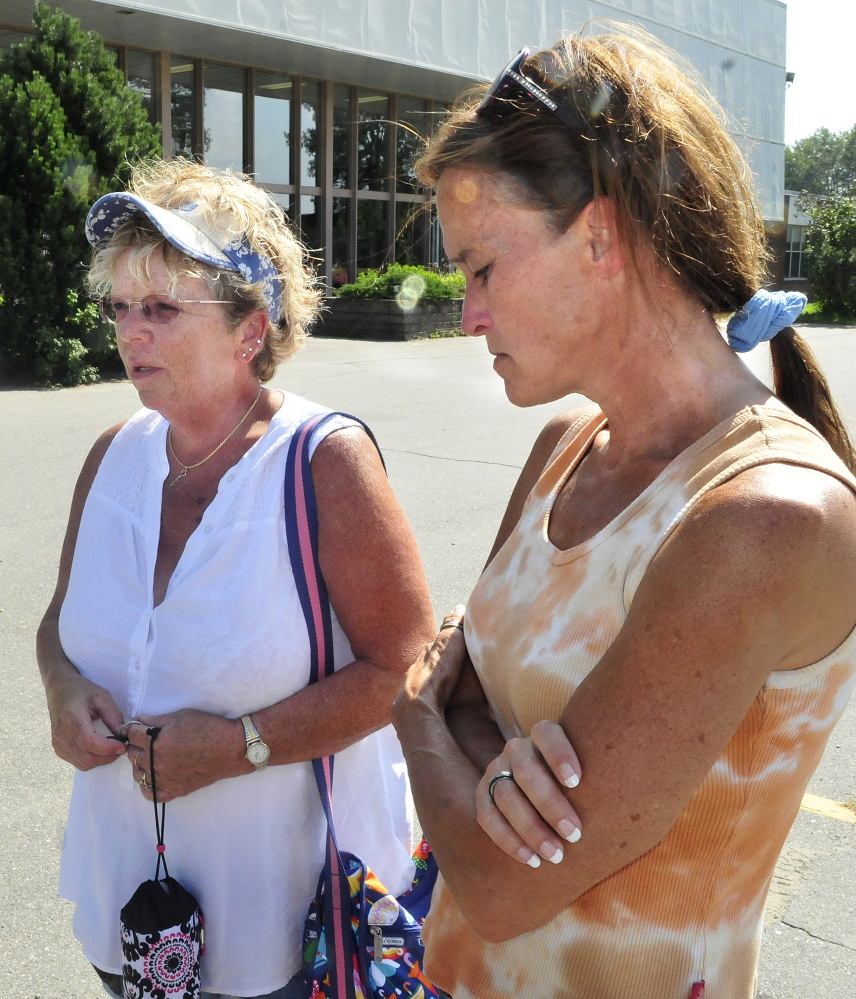 Brenda Waugh, left, an aunt of Scott Brown's, and his grandmother Pam Mattson speak about the teenage Skowhegan Area High School student and football player on Monday outside the school. Brown died Sunday evening while swimming in Embden Pond in Embden.