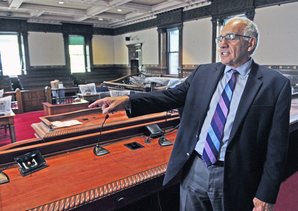 Supreme Court Justice Joseph Jabar talks about additions to the bench during a tour Thursday of the recently renovated old courtroom in the Kennebec County Courthouse in Augusta. The judges' bench has been enlarged so the seven members of the Maine Supreme Judicial Court can hear cases there.