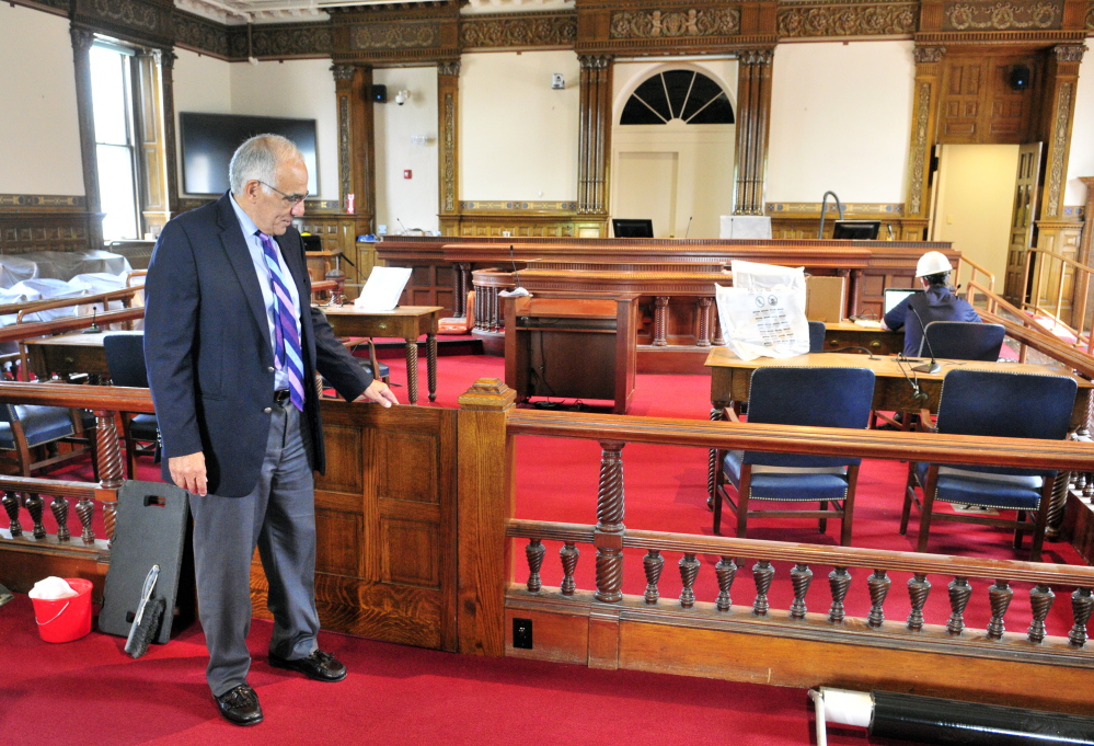 Supreme Court Justice Joseph Jabar points out a new gate Thursday during a tour of the recently renovated old courtroom in the Kennebec County Courthouse in Augusta.