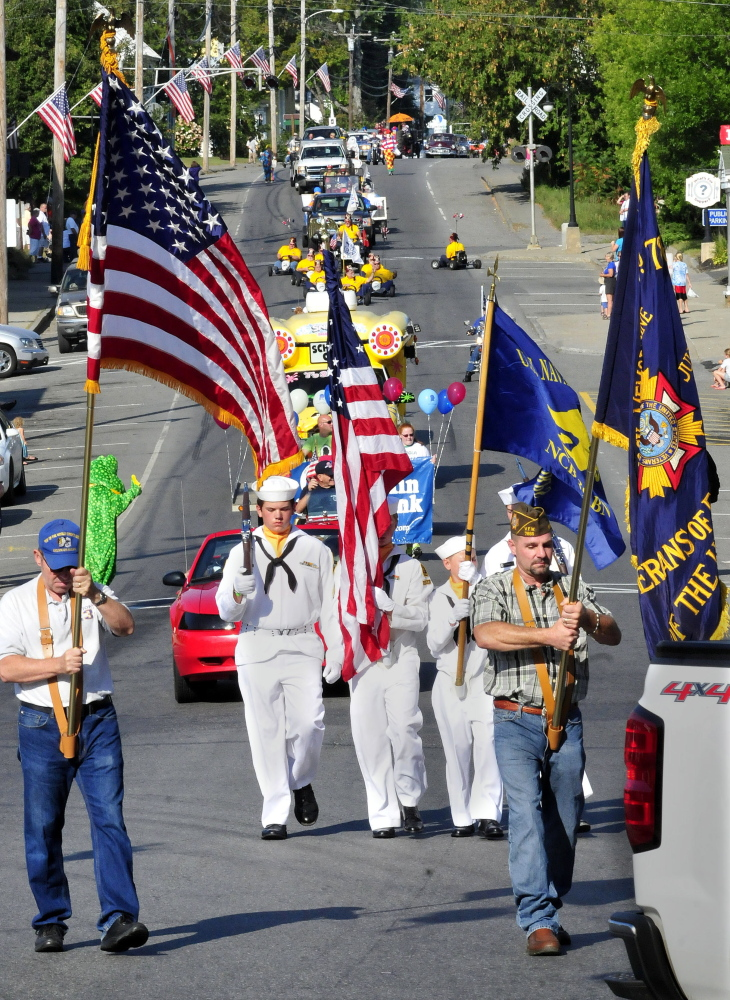 a color guard leads the oosoola days parade down main street monday in norridgewock