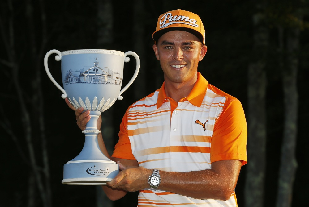 Rickie Fowler holds the trophy after winning the Deutsche Bank Championship Monday in Norton, Mass.