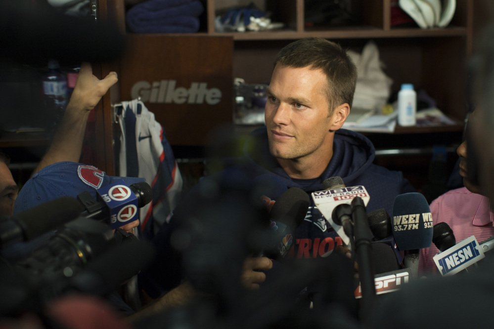 New England Patriots quarterback Tom Brady speaks in the locker room at Gillette Stadium prior to the team's practice Sunday in Foxborough, Mass.