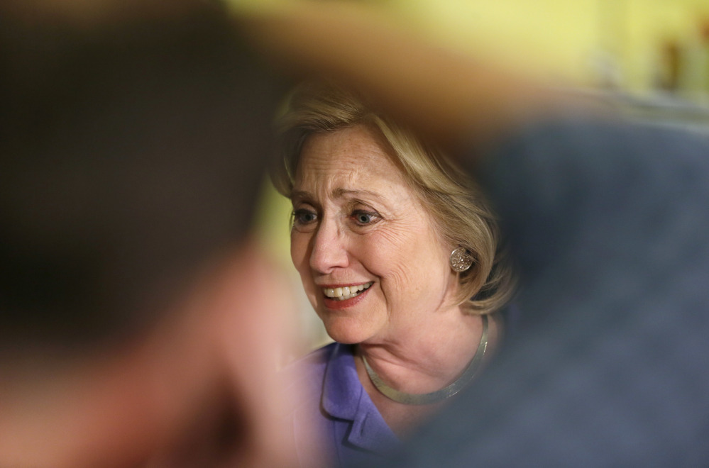 Democratic presidential candidate Hillary Rodham Clinton greets supporters during a campaign stop at Uncle Nancy's Coffee House, Sunday, in Newton, Iowa.