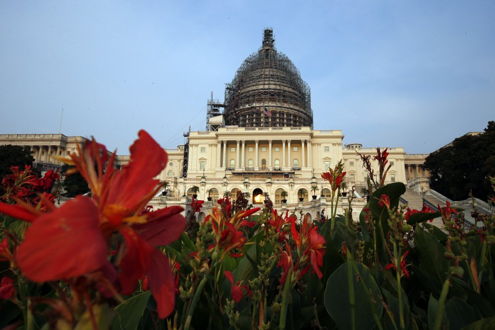 The west front of the U.S. Capitol is seen under repair, Wednesday in Washington.