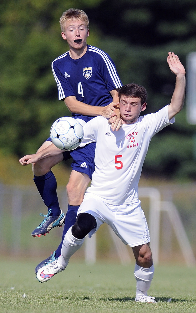 Staff photo by Andy Molloy   Cony High School's Tyler Sproul, right, attempts to block Mt. Blue's Thomas Wing during a Kennebec Valley Athletic Conference Class A game Tuesday in Augusta.