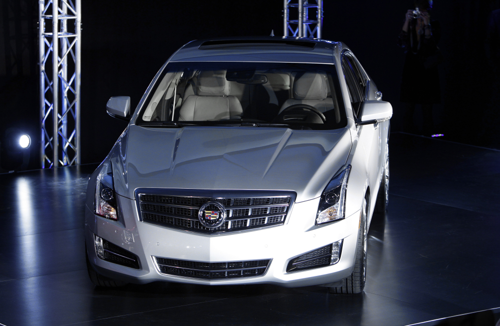 This Jan. 8, 2012 file photo shows the 2013 Cadillac ATS as it makes its debut prior to the North American International Auto Show in Detroit.  General Motors is recalling about 121,000 Cadillacs because the rear window defroster control can overheat and catch fire.