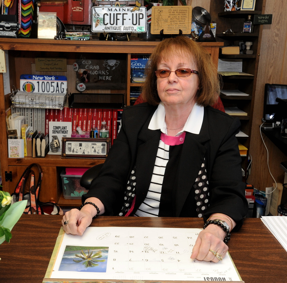 Claudia Viles, the elected tax collector for the town of Anson, sits at her desk at the town office in Anson on Thursday.