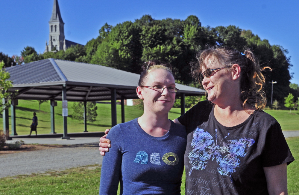 Shauna Wade, left, and her mother Jessica Ward stand together on Friday at Mill Park in Augusta, where a vigil is planned for Sunday to offer support and highlight the struggle of addiction.