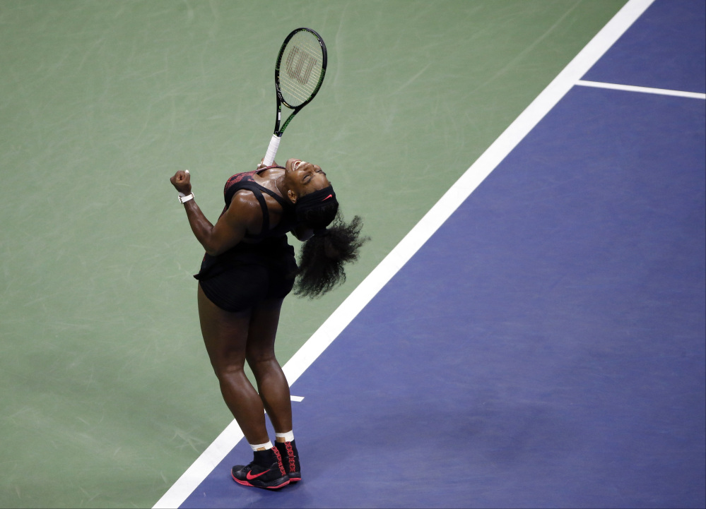 AP photo   Serena Williams reacts after beating sister Venus Williams during a quarterfinal match at the U.S. Open on Tuesda in New York.