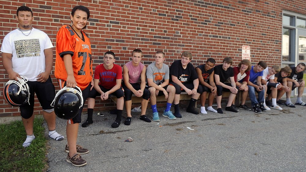 Members of the Gardiner football team have all eyes on Alex Thang and his sister, Kassidy, on Wednesday at the high school.
