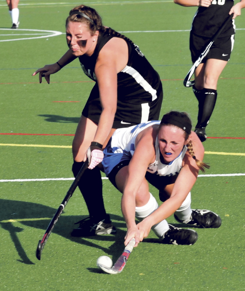 Staff photo by David Leaming   Thomas' Erica Blake, left, and Colby's Megan Fortier go after the ball during a non-conference game Wednesday at Thomas.