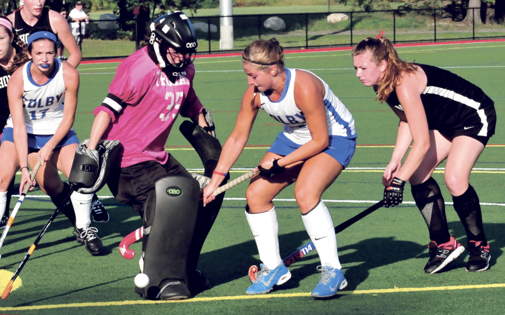 Staff photo by David Leaming   Thomas goalie Abbie Charrier blocks a shot from Colby's Misha Strage during a non-conference game Wednesday night at Thomas College. Colby prevailed 4-2.