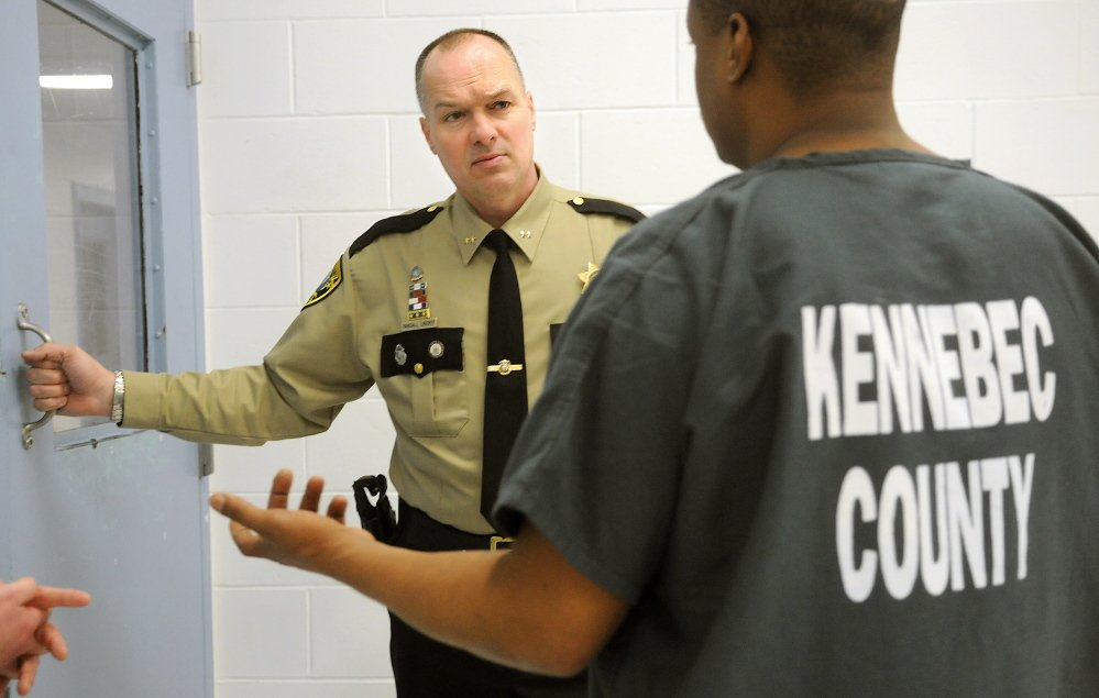 Kennebec County Sheriff Randy Liberty, who was named warden of the Maine State Prison on Thursday, confers with an inmate at the Kennebec County Correctional Facility in Augusta in this April file photo.