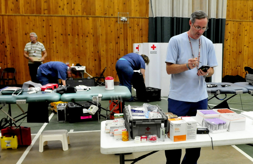 Alan Pratt, supervisor for the American Red Cross team that operated a blood drive in Belgrade on Thursday, with other staff closes the event held at the Community Center for All Seasons. Another driver, part of the Red Cross 9/11 rememberance, will be held at the Augusta Civic Center Friday.