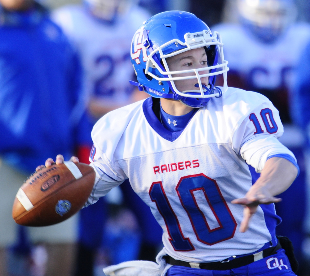 Staff file photo by Joe Phelan Oak Hill quarterback Dalton Therrien prepares to throw a pass during the Class D state game against Maine Central Institute last November. Therrien and the Raiders host Dirigo on Saturday in a key Southern D Campbell Conference game.