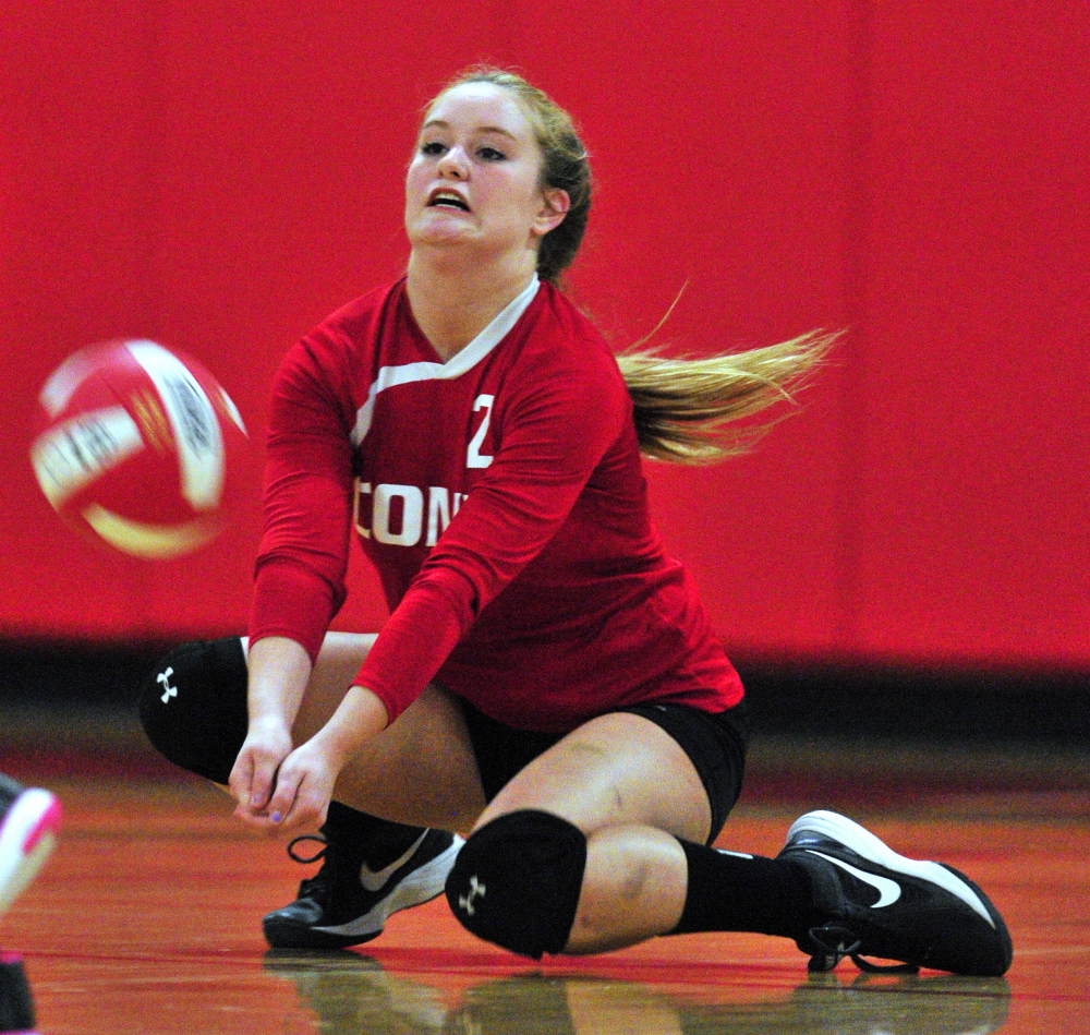 Staff photo by Joe Phelan Cony's Hailey Greene digs out a ball against Gorham on Thursday at Cony High School in Augusta.
