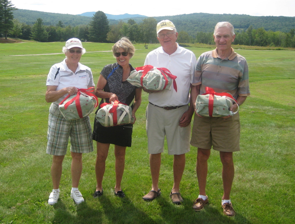 Lowest net winners, from left, are Suzanne Twitchell, Nancy Stowell, John Cureton and Dick Stowell.
