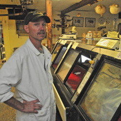 Todd Ballard, store manager, talks about the shop closing down on Friday at Ballard Meats & Seafood in Manchester.