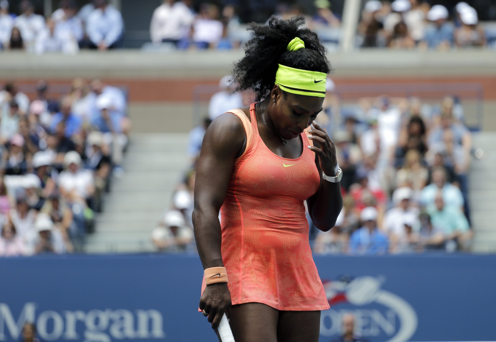 AP photo Serena Williams reacts after losing a point to Roberta Vinci during a U.S. Open semifinal match Friday in New York.