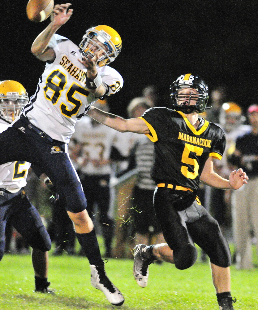 Boothbay's Abel Bryer, left, knocks away a pass intended for Maranacook's Brandyn Michaud on Friday night at Ricky Gibson Field of Dreams in Readfield.