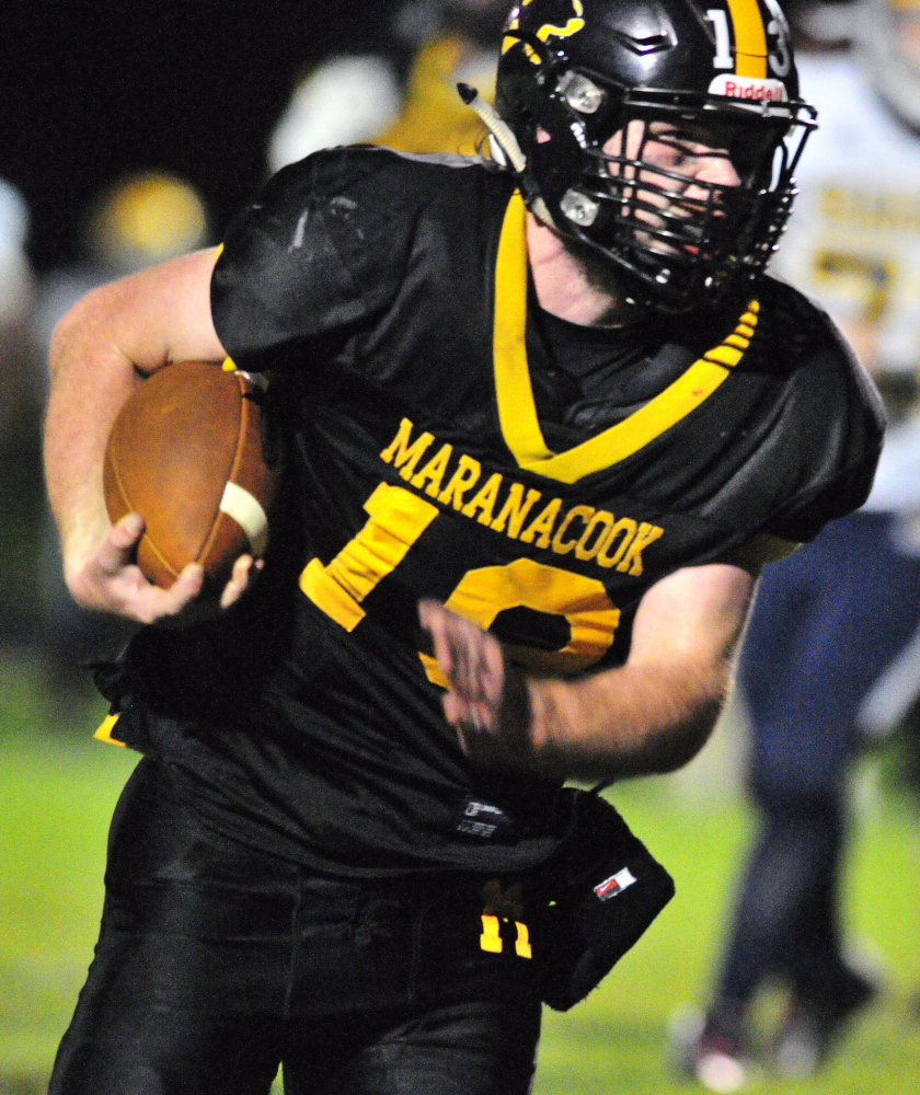 Maranacook quarterback Kyle Morand runs for a touchdown during the second quarter of a game against Boothbay on Friday night at Ricky Gibson Field of Dreams in Readfield.