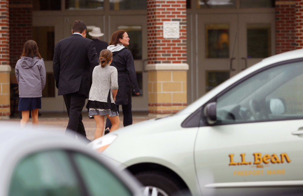 Mourners arrive at the memorial service of Leon Gorman at the Westbrook Performing Arts Center on Sunday.