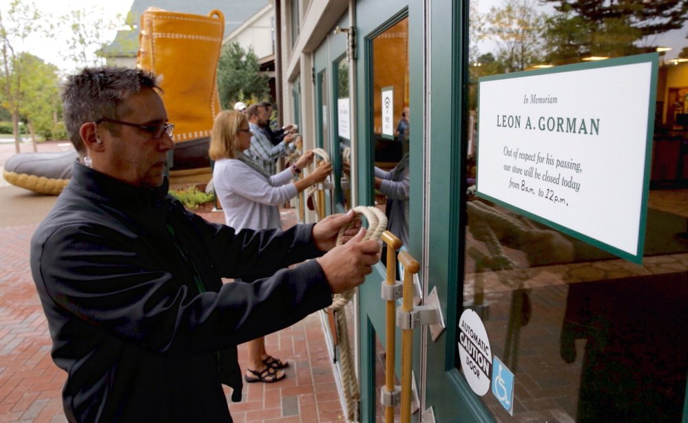 Assistant store manager Matthew Hamly is one of four L.L. Bean employees ceremoniously closing the flagship store in Freeport. The store, which famously doesn't have locks, was closed with lengths of rope tied with an overhand knot.