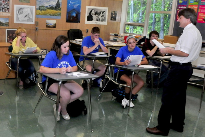 Upper Kennebec Valley Memorial High School teacher John Berube teaches at the Bingham school on Wednesday. The school was ranked 175th out of 500 by Newsweek for its efforts to send low-income students to college.