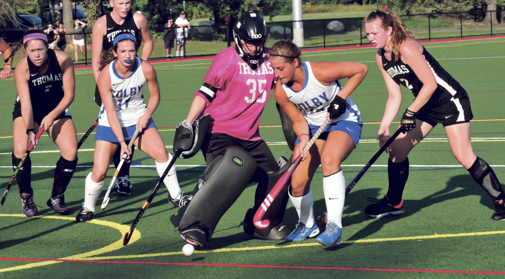 Thomas College goalie Abbie Charrier makes a save during a recent game against Colby College.