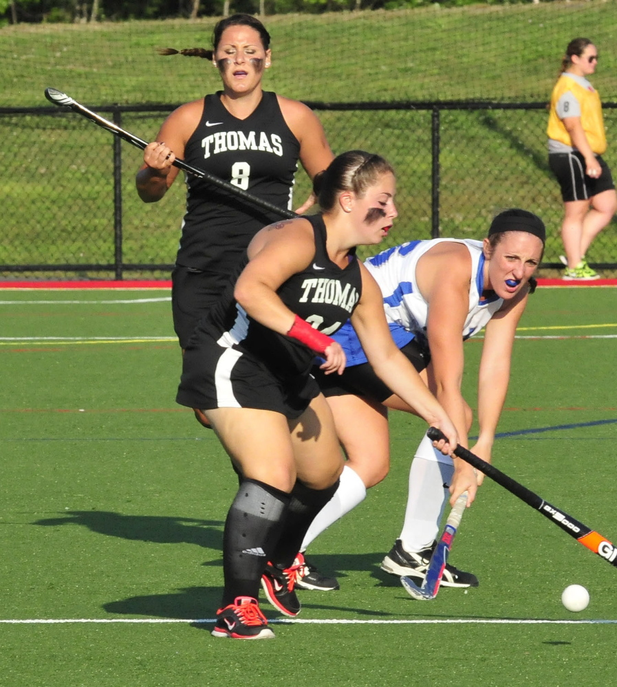 Thomas'  Lindsay Morong battles for possession as teammate Emily Leighton backs up during a recent game against Colby in Waterville.