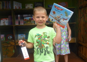Caleb O'Rourke, an Educare Central Maine preschooler, shows off his new book about planes.