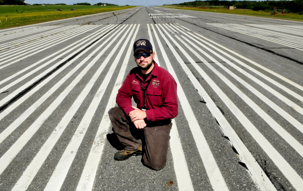 Robert Lafleur Airport Manager Randy Marshall on the primary runway at the Waterville airport last September. The City Council Tuesday will be updated on an upgrade to the airport's longest runway.