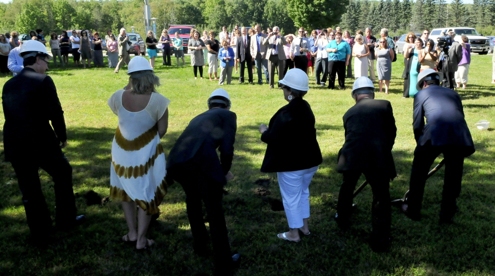 A large crowd of supporters watch as officials take part in a groundbreaking ceremony for the Woodfords Family Services building on Chase Avenue in Waterville. The center will be on the same site as the former Seton Hospital, which developer Kevin Mattson said Tuesday he plans to turn into apartments.