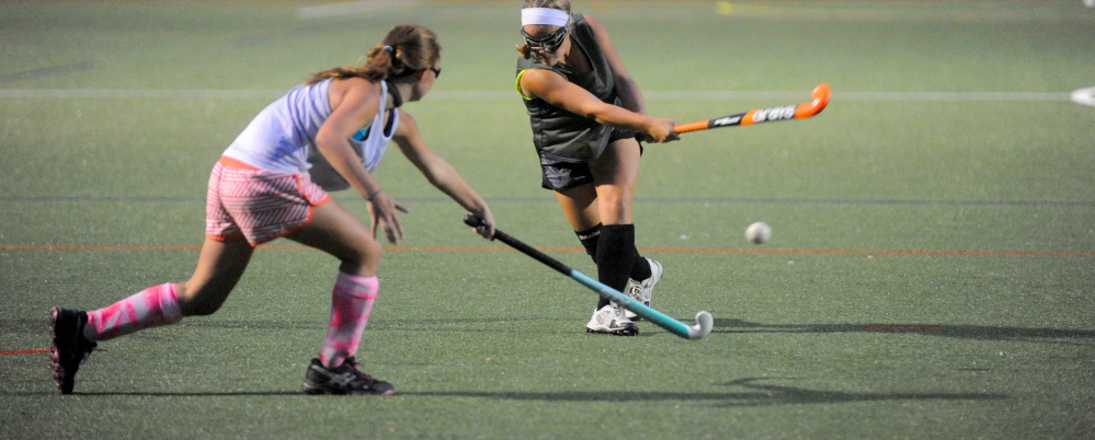 The Winslow High School field hockey team practices on the artificial turf at Thomas College last October.