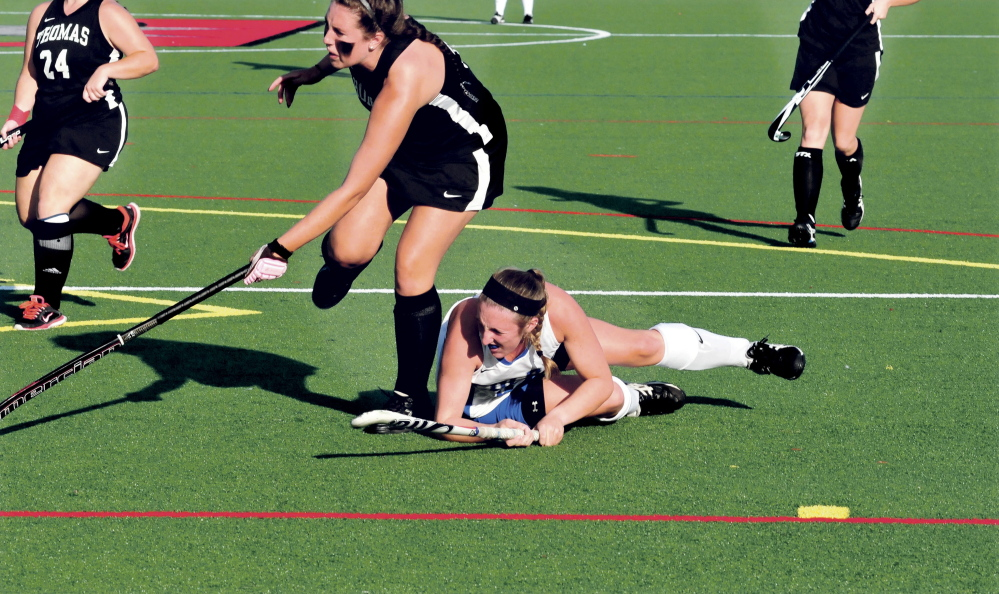 Thomas and Colby College field hockey players play on artificial turf during a recent game.