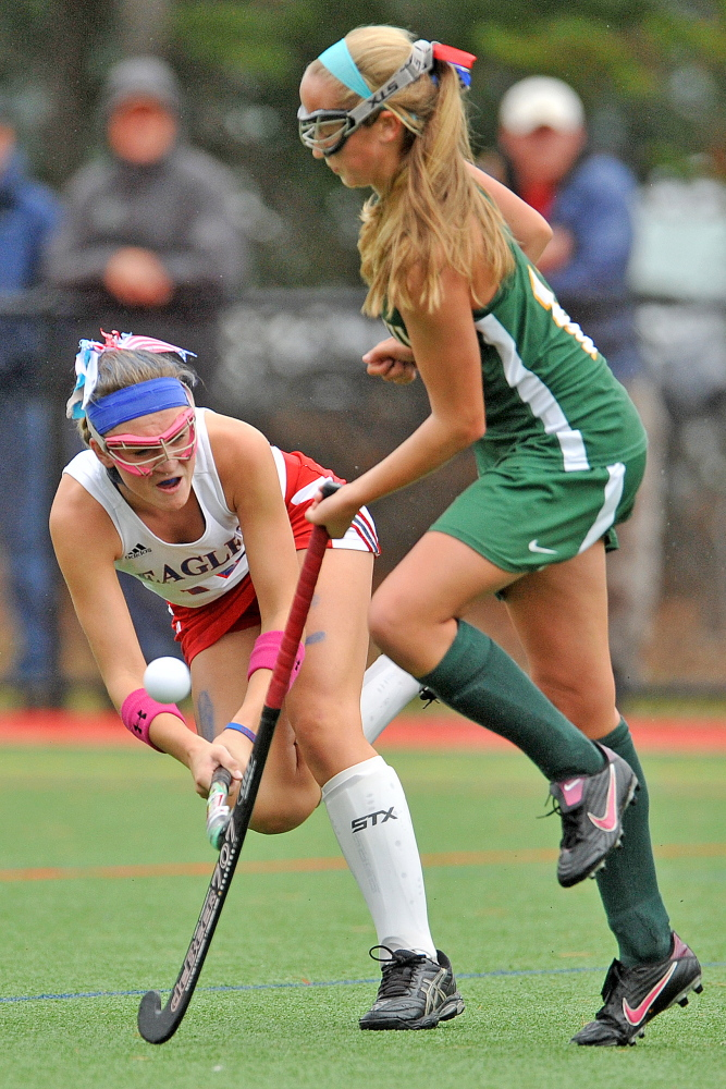 Messalonskee's Riley Field, left, battles for the ball with Oxford Hills' Allysa Turner in the first half of an Eastern A quarterfinals game at Thomas College in Waterville last October.