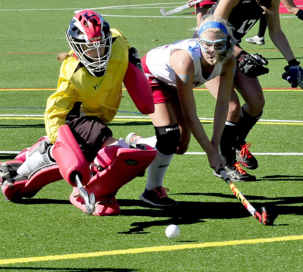 Messalosnkee's Nathalie St. Pierre, right, tries to get the ball past Skowhegan goalie Leah Kruse during game last Oct. 13 at Thomas College.