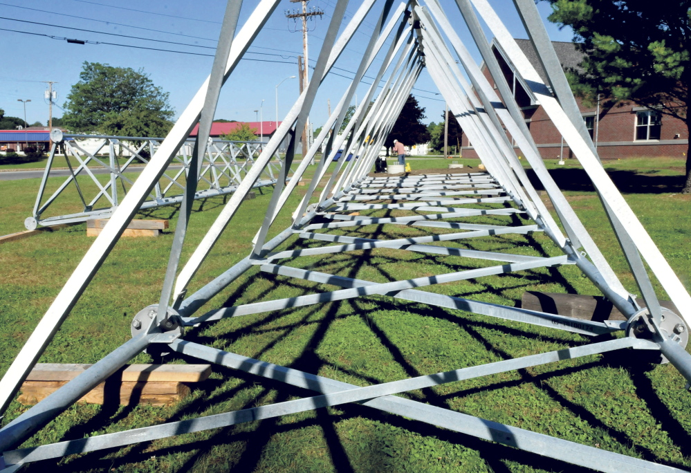 Matt Hussey of Hussey Communications, center, makes preparations on Tuesday to intall the 140-foot radio tower in front of the Waterville Police Department. The company will put up the 140-tower beginning at 9 a.m. Thursday.