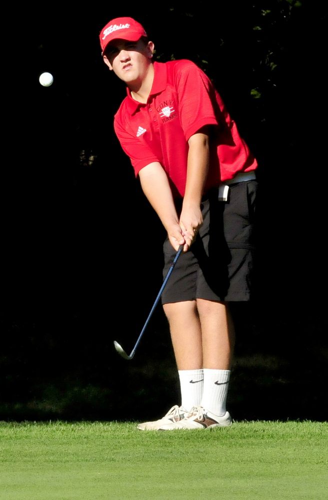 Cony's Jake Whitley chips a shot during match against Lawrence on Wednesday at Clinton Golf Course. Whitley defeated Michaela Hues 3 and 2. The Rams won the match 9-0.