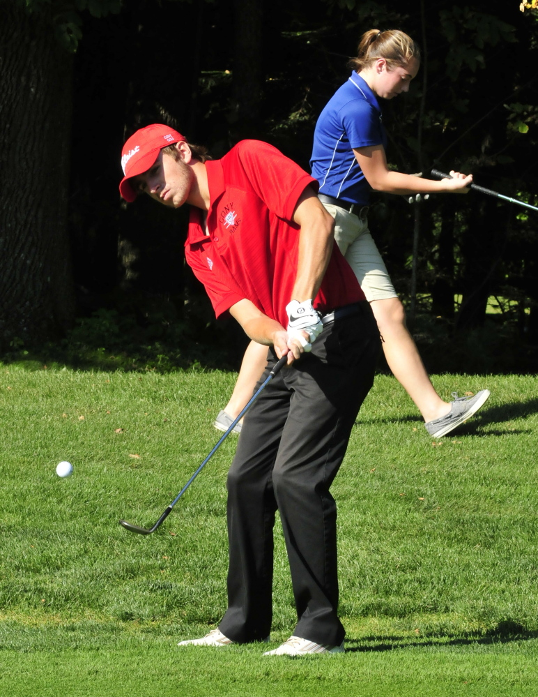 Cony's Justin Rodrigue chips on the third hole in a match against Lawrence on Wednesday at the Clinton Golf Course. Lawrence's Michaela Hues is in background. Rodrigue shot a 49 as the Rams defeated the Bulldogs 9-0.