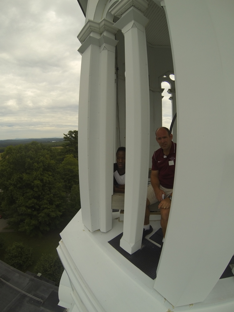 Emmanuel Bajjabayira, left, and teacher Steve Stortz look out over the scenic view from the bell tower atop Bearce Hall lsat week on the Kents Hill School campus in Readfield.