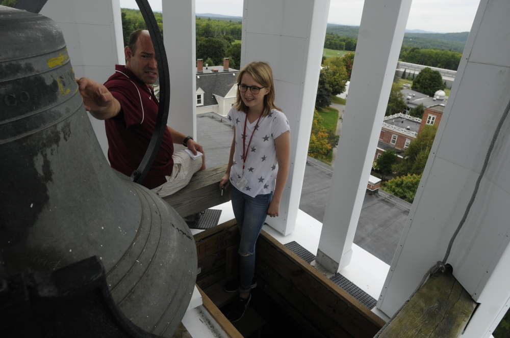 Teacher Steve Stortz tells freshman Luise Prinzessin Zur Lippe about the bell that is rung after sports teams' wins and other special occasions, atop Bearce Hall on Thursday on the Kents Hill School campus in Readfield.