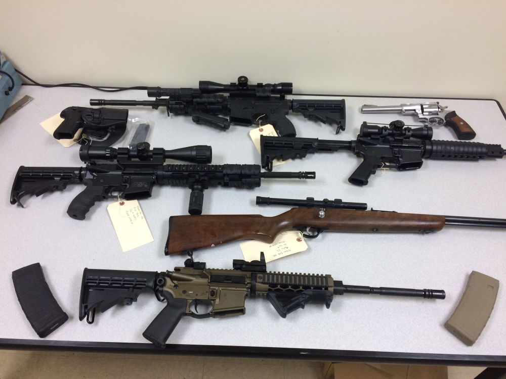 Firearms seized by the Somerset County Sheriff's Office that authorities say were being illegally possessed by Michael Kelly of Embden.