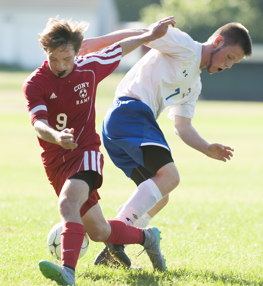Kevin Bennett photo   Cony's Brett Sproul, left, and Messalonskee's Dan Turner seek control of the ball during a Kennebec Valley Athletic Conference Class A game Friday afternoon.